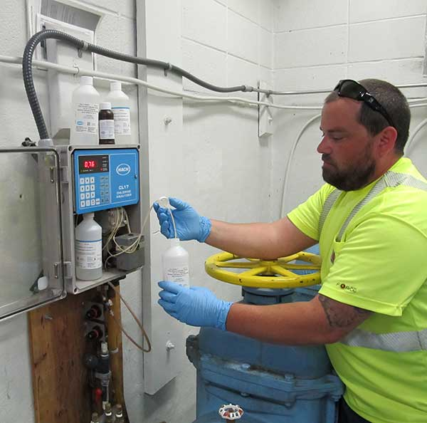 North City Water District staff monitoring water inside a pump station